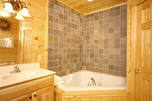 Jacuzzi in master bath at Moose Mountain Lodge, a 4 bedroom cabin rental located in Gatlinburg