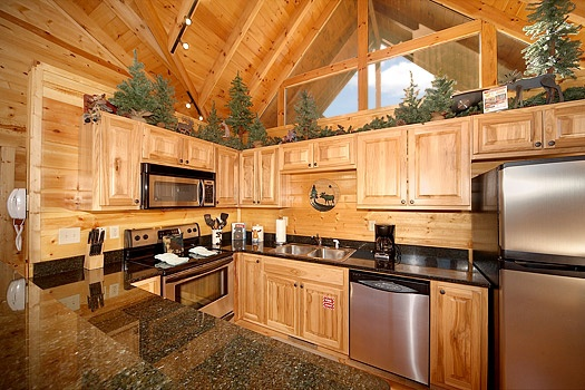 kitchen with stainless steel appliances at moose mountain lodge a 4 bedroom cabin rental located in gatlinburg