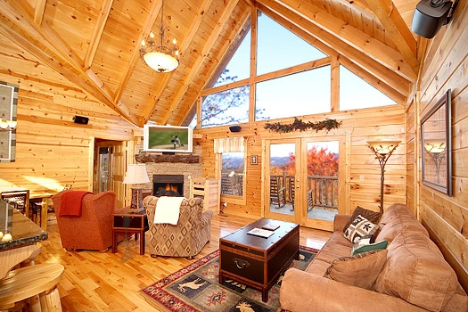 living room with fireplace at moose mountain lodge a 4 bedroom cabin rental located in gatlinburg