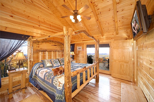 main level bedroom with king bed at moose mountain lodge a 4 bedroom cabin rental located in gatlinburg