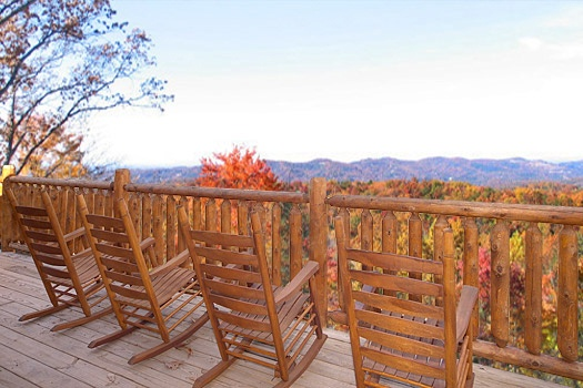Upper level deck with rocking chairs at Moose Mountain Lodge, a 4 bedroom cabin rental located in Gatlinburg