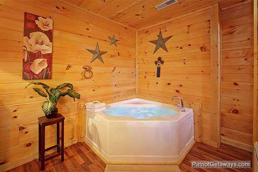 In bedroom jacuzzi tub at Paradise Found, a 1 bedroom cabin rental located in Gatlinburg