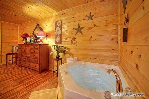Jacuzzi tub in king bedroom at Paradise Found, a 1 bedroom cabin rental located in Gatlinburg