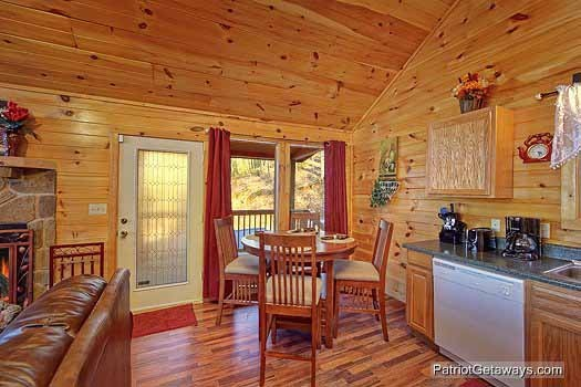 kitchen and dining area at paradise found a 1 bedroom cabin rental located in gatlinburg