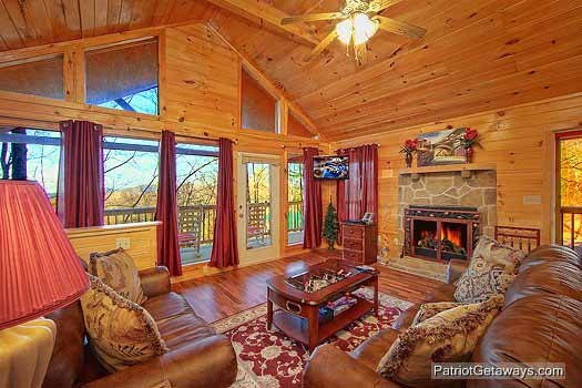 living room with fireplace at paradise found a 1 bedroom cabin rental located in gatlinburg