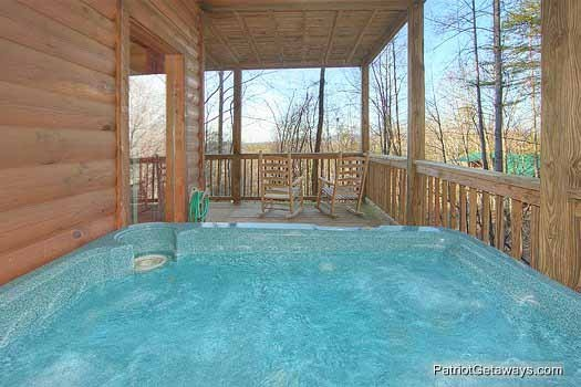 lower level deck with hot tub at paradise found a 1 bedroom cabin rental located in gatlinburg