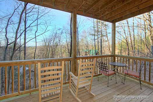 Lower level deck with rocking chairs at Paradise Found, a 1 bedroom cabin rental located in Gatlinburg