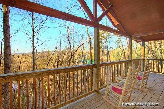 Upper level deck with rocking chairs at Paradise Found, a 1 bedroom cabin rental located in Gatlinburg