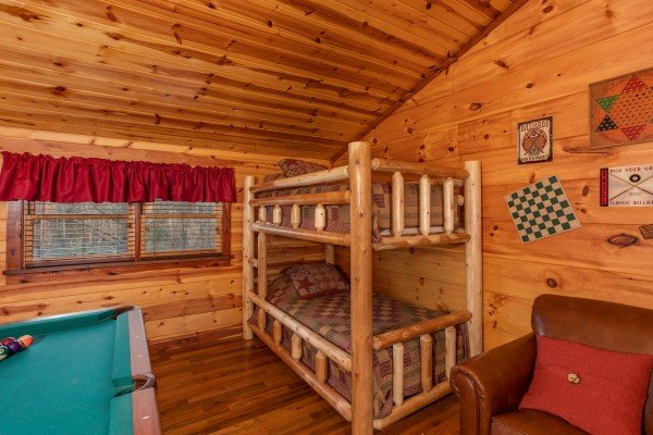 Log bunk bed in the loft space at Moonshiner's Ridge, a 1-bedroom cabin rental located in Pigeon Forge