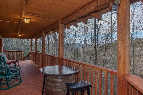 Deck seating and winter views at Moonshiner's Ridge, a 1-bedroom cabin rental located in Pigeon Forge