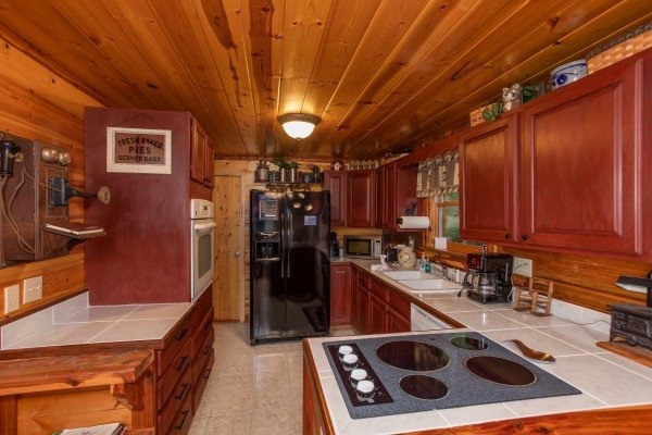 Kitchen at Moonshiner's Ridge, a 1-bedroom cabin rental located in Pigeon Forge