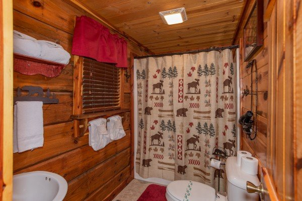 Bathroom on the main floor at Moonshiner's Ridge, a 1-bedroom cabin rental located in Pigeon Forge