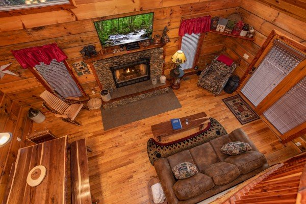 Living room from the upper floor at Moonshiner's Ridge, a 1-bedroom cabin rental located in Pigeon Forge