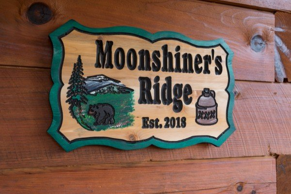 Custom welcome sign at Moonshiner's Ridge, a 1-bedroom cabin rental located in Pigeon Forge