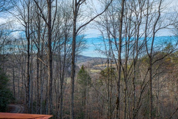 Mountain and valley views from the deck in winter at Moonshiner's Ridge, a 1-bedroom cabin rental located in Pigeon Forge