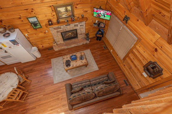Looking down at the living room at Smoky Bears Creek, a 2 bedroom cabin rental located in Pigeon Forge