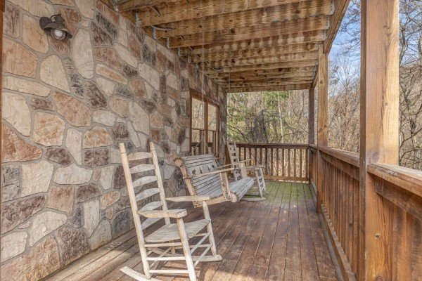 Porch with rocking chairs and a swing at Smoky Bears Creek, a 2 bedroom cabin rental located in Pigeon Forge