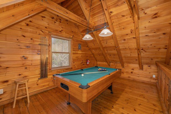 Pool table in the loft at Smoky Bears Creek, a 2 bedroom cabin rental located in Pigeon Forge