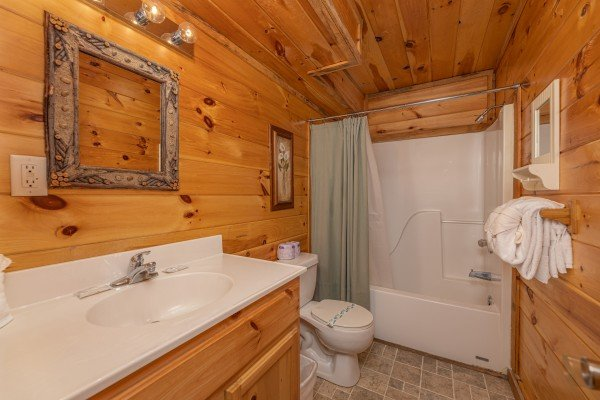 Bathroom with tub and shower at Smoky Bears Creek, a 2 bedroom cabin rental located in Pigeon Forge