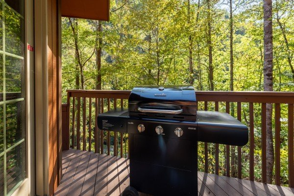 Grill on a covered deck at Rustic Retreat at Shagbark, a 2 bedroom cabin rental located in Pigeon Forge