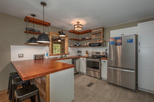 Kitchen with stainless appliances at Rustic Retreat at Shagbark, a 2 bedroom cabin rental located in Pigeon Forge