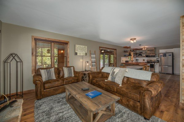 Sofa, loveseat, and coffee table in the living room at Rustic Retreat at Shagbark, a 2 bedroom cabin rental located in Pigeon Forge