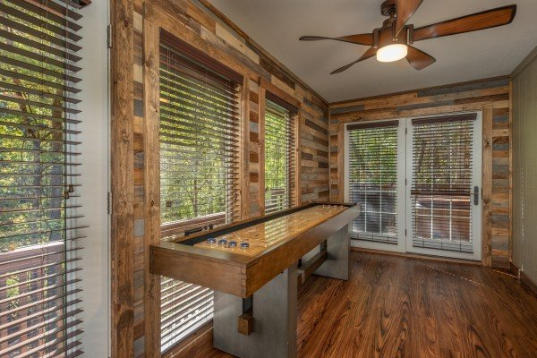 Shuffleboard table at Rustic Retreat at Shagbark, a 2 bedroom cabin rental located in Pigeon Forge
