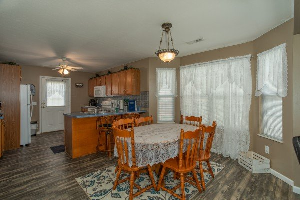 Dining table for six at Peace at the River, a 3 bedroom cabin rental located in Pigeon Forge