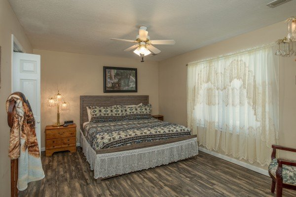 Bedroom with a king bed at Peace at the River, a 3 bedroom cabin rental located in Pigeon Forge
