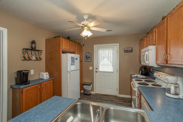 White appliances in a kitchen at Peace at the River, a 3 bedroom cabin rental located in Pigeon Forge