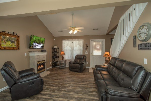 Living room with fireplace and TV at Peace at the River, a 3 bedroom cabin rental located in Pigeon Forge