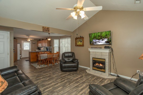 Living, dining, and kitchen space on the main floor at Peace at the River, a 3 bedroom cabin rental located in Pigeon Forge