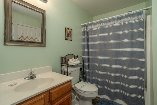 Bathroom with a tub and shower at Peace at the River, a 3 bedroom cabin rental located in Pigeon Forge