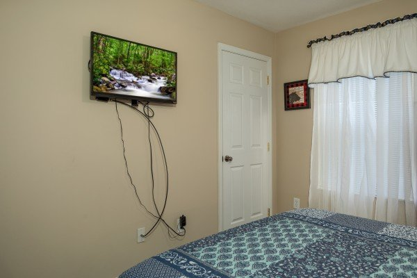 TV in a bedroom at Peace at the River, a 3 bedroom cabin rental located in Pigeon Forge