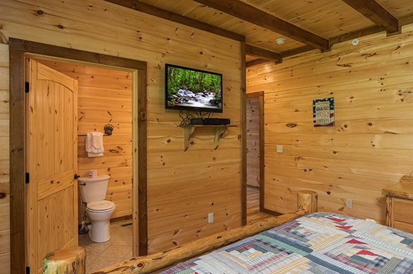 bedroom with attached bath at amazing grace a 3 bedroom cabin rental located in pigeon forge