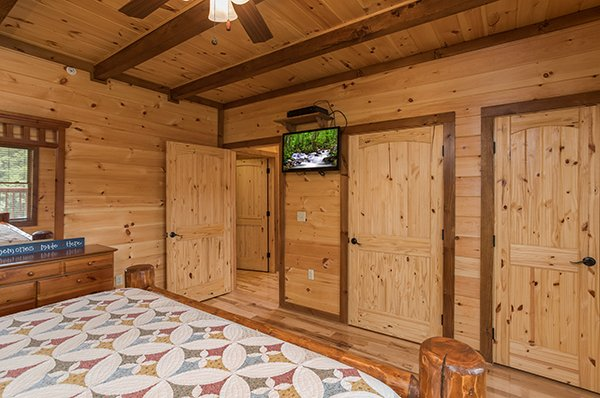 wall mounted television in a bedroom at amazing grace a 3 bedroom cabin rental located in pigeon forge