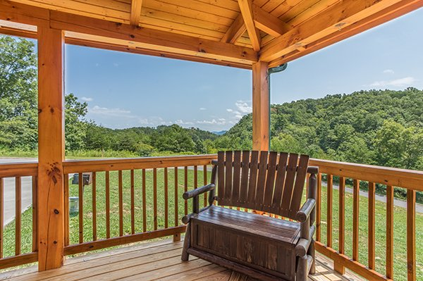 bench seating on the covered deck at amazing grace a 3 bedroom cabin rental located in pigeon forge