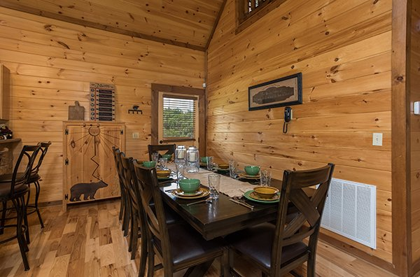 dining table with seating for eight at amazing grace a 3 bedroom cabin rental located in pigeon forge