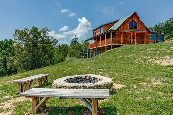 fire pit with bench seating at amazing grace a 3 bedroom cabin rental located in pigeon forge
