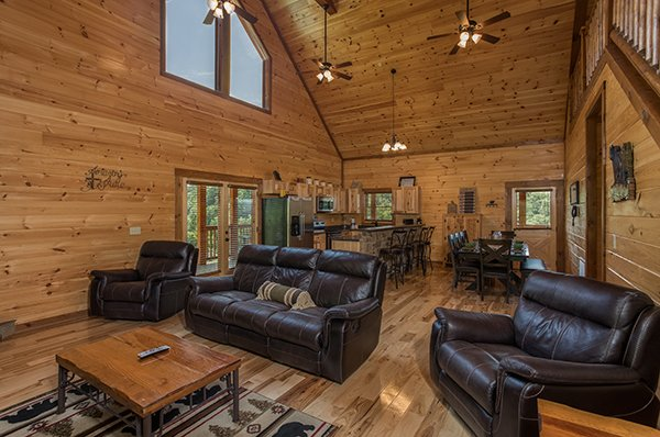 living room with a couch two chairs and vaulted ceiling at amazing grace a 3 bedroom cabin rental located in pigeon forge
