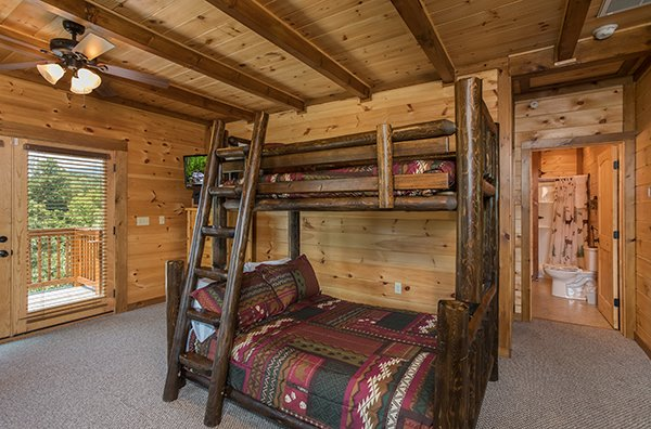 bunk bed with a full and twin size bed at amazing grace a 3 bedroom cabin rental located in pigeon forge