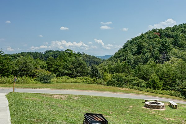 view of the grill and fire pit at amazing grace a 3 bedroom cabin rental located in pigeon forge