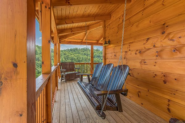 porch swing on a covered deck at amazing grace a 3 bedroom cabin rental located in pigeon forge