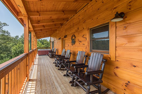 rocking chairs on a covered deck at amazing grace a 3 bedroom cabin rental located in pigeon forge