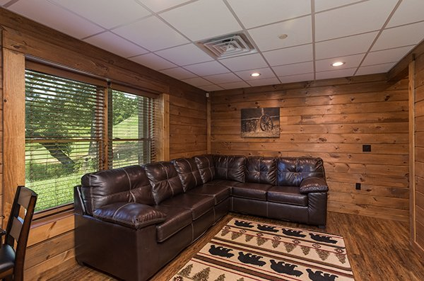 sectional sofa in the game room at amazing grace a 3 bedroom cabin rental located in pigeon forge