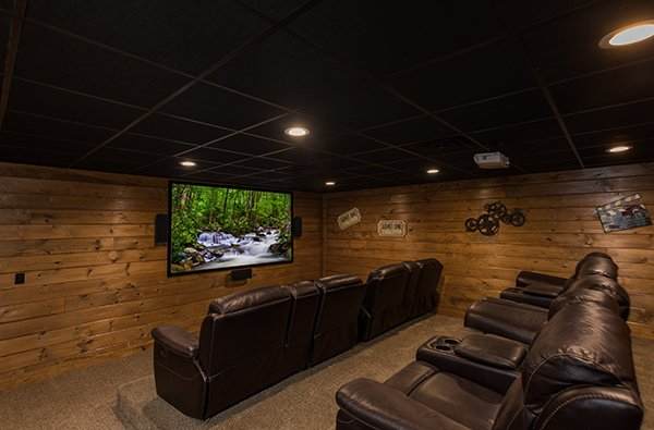 theater room with tiered seating at amazing grace a 3 bedroom cabin rental located in pigeon forge