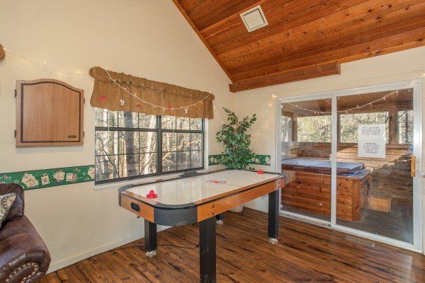 Air hockey table in the den at Hillside Hideaway, a 1 bedroom cabin rental located in Pigeon Forge