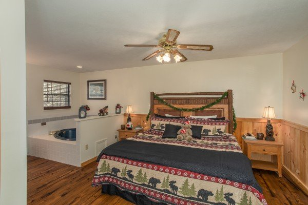 Bedroom with a king bed and in room jacuzzi at Hillside Hideaway, a 1 bedroom cabin rental located in Pigeon Forge