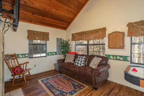 Sleeper sofa in the den at Hillside Hideaway, a 1 bedroom cabin rental located in Pigeon Forge