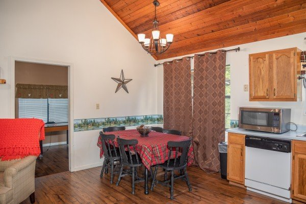 Dining space for six at Hillside Hideaway, a 1 bedroom cabin rental located in Pigeon Forge